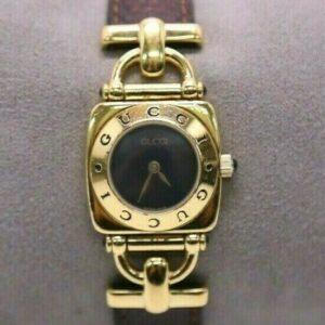 Reloj de pulsera vintage para mujer Gucci en tono dorado 6300L Correa de cuero marrón