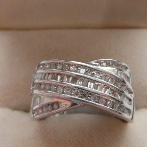 Q27 Ladies 9ct white gold 0.50 carat brilliant and baguette diamond dress ring