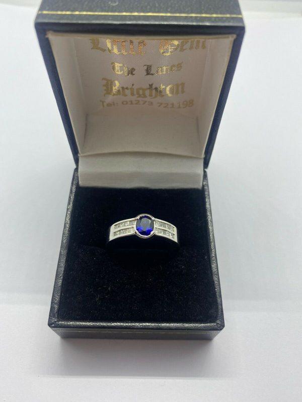 sapphire and diamond Oval ring Princess Cut Diamonds