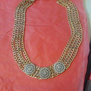 Gold bib statement necklace